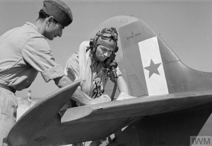 A pilot from the Balkan Air Force (BAF) 352 (Yugoslav) Squadron signs his aircraft serviceability report prior to flight. The BAF was officially created on 7th June 1944. (IWM, London, photographic archive, CNA 3099)