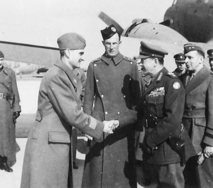 Supreme Commander of the Allied Forces Headquarters in the Mediterranean, Field Marshal Alexander, arrives in Belgrade 21st February 1945 and is greeted by his escort General Arso Jovanović. (IWM, London, photographic archive, NA22516)