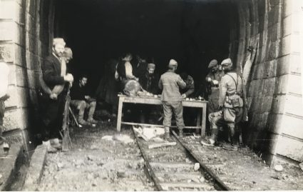 Major Archie Jack and JVuO engineers take shelter in a tunnel leading to the Lim railway bridge near Visegrad, in order to prepare charges for its destruction. (IWM, London, Documents archive 12697)