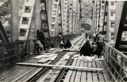 Major Archie Jack and JVuO engineers laying their charges on Lim railway bridge. (IWM, London, Documents archive 12697.