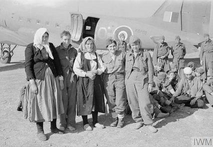 Partisan women after landing in Bari next to a C-47 aircraft. (IWM, London, photographic archive, CNA 3069)