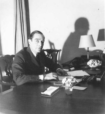 Ambassador Ralph Stevenson at his desk in Belgrade. (IWM, London, photographic archive, NA23361)