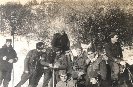 Sergeant McFarlane, Colonel Bailey, and Brigadier Armstrong with their radio operators and JVuO escorts study a map whilst on the move. (Personal photographic collection of Mr. Harry Fenney)