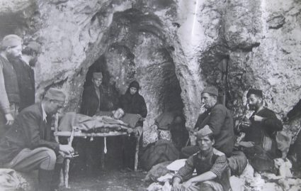 General Draža Mihailović and his staff in a cave somewhere in Serbia. This image is included in Colonel Bailey's report on medical conditions with the JVuO dated April 1944. (National Archives, London, Document HS7-202)
