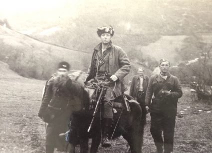 Sergeant McFarlane moving with JVuO guides through Serbia. (Personal photographic collection of Mr. Harry Fenney)