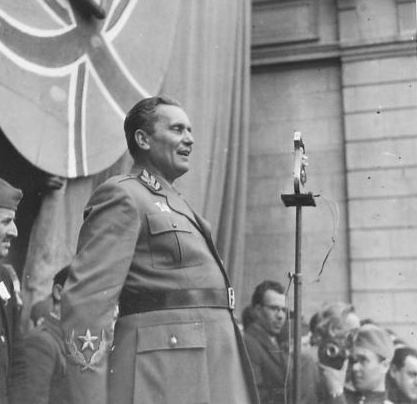 Marshal Tito, with a Union Flag clearly visible behind him, addresses the crowds on 27th March 1945. (IWM, London, photographic archive, NA23613)