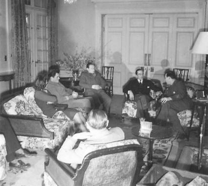 The British Ambassador and staff in discussions with Vladimir Dedjier in the British Embassy. (IWM, London, photographic archive, NA23371)