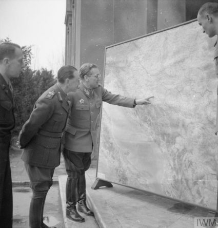 Marshal Tito describes his plans for the March 1945 offensive on the Srem Front to Field Marshal Alexander. (IWM, London, photographic archive, NA22637)
